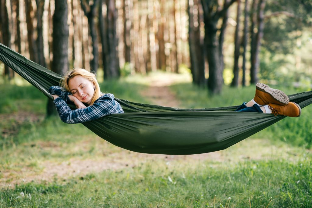 Young woman sleeping in hammock