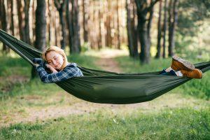 Young woman sleeping in hammock