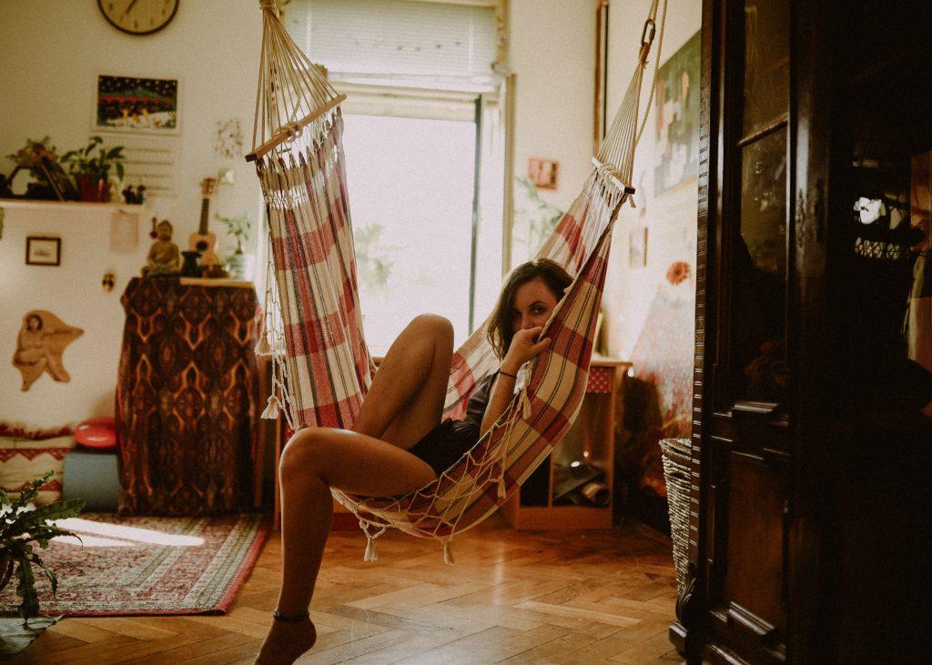 woman sitting on hammock chair